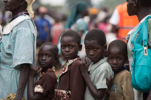 South Sudanese refugees wait to be registered at a UNHCR collection point in Elego, Uganda.