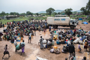South Sudanese refugees gather at a UNHCR collection center on the South Sudan border in Egelo, Uganda.