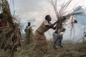 A refugee from South Sudan clears her newly assigned plot where she will live with her family in Pagarinya 2 camp in Adjumani District, northern Uganda.  Esther Ojabajon, 43 from Arapi in Eastern Equatoria, South Sudan fled with her children when gunfire erupted in their village one evening.