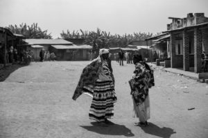 Women chat after a church service in the village centre of the Tutsi refugee camp in Ruhuroro. Despite attempts by government and NGOs to bring reconciliation, both tutsi and Hutu communities are still wary of each other.