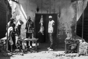 Men sell grilled goat in the Tutsi area of the Ruhuroro in central Burundi.