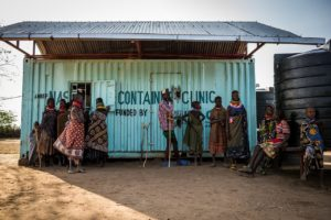 Members of the Turkana tribe wait outside a mobile 'container clinic' operated by the charity African Medical Research Centre in Turkana, northern Kenya. The clinic moves with the nomadic tribe to provide basic health services. © Will Swanson for Al Jazeera Magazine