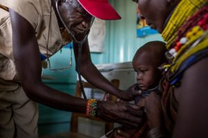 A medical officer with the charity African Medical Research Institute conducts a check up on a young Turkana resident at a mobile clinic in north Kenya. © Will Swanson for al Jazeera Magazine