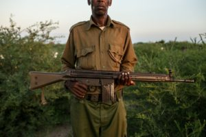 A Kenya police reservist poses with his 30 year old ex-army rifle issued to him by the government. The Kenyan government is equipping a local paramilitary force in its border areas with Somalia to bolster its security in the face of a growing al Shabaab insurgency. © Will Swanson for Foreign Policy Magazine