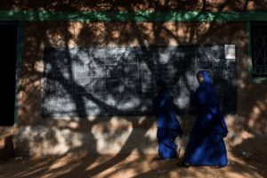 Students walk to class at the Mandera Academy, a private school in Mandera town that lost five teachers in an ambush on a bus by the Somali insurgent group al Shabaab. © Will Swanson for The New York Times